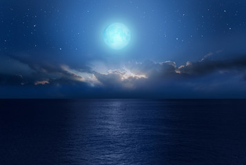 """Night sky with moon in the clouds """"Elements of this image furnished by NASA"""