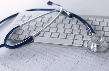 Close up of stethoscope on pc keyboard. Healthcare concept