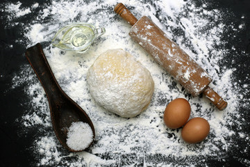 Ingredients for bread making from dough. Flour egg and oil salt