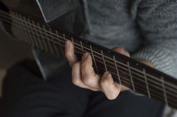 Elderly man playing carbon fiber guitar