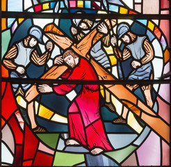 LONDON, GREAT BRITAIN - SEPTEMBER 16, 2017: The stained glass of Jesus under the cross in church St Etheldreda by Charles Blakeman (1953 - 1953).
