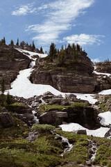 Frozen glacier on rock mountain