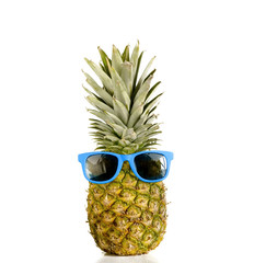 Pineapple with sunglasses, travel,holiday tropical metaphor.