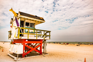 colorful lifeguard tower in miami beach during cloudy day