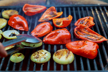 Grilled red sweet pepper and onion on roasting