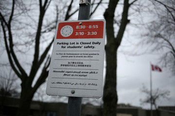 A multilingual sign is posted outside Pauline Johnson Junior Public School in Toronto