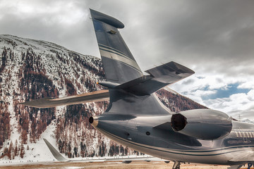 A view of a tail of a private jet in the alps