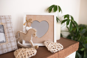 wooden photo frame in the shape of heart. beautiful interior details