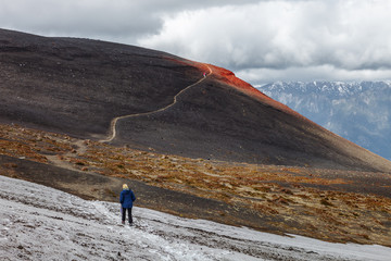 Trekking on the slope of the Osorno volcano, Chile.