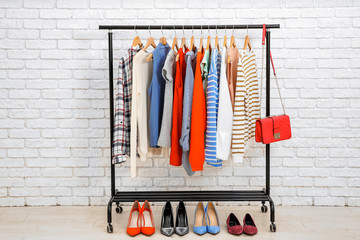 Rack with collection of clothes in dressing room