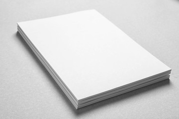 Blank sheets of paper on light background. Mock up for design