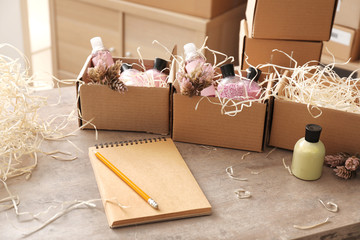 Preparing parcels for shipment to customer on table