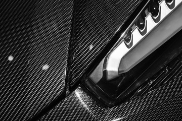 Headlight mounted in carbon fiber of sports car