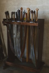 Sword arranged on wooden rack
