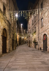 Gubbio (Italy) - One of the most beautiful medieval towns in Europe, in the heart of the Umbria Region, central Italy. Here in particular the historic center in the night.