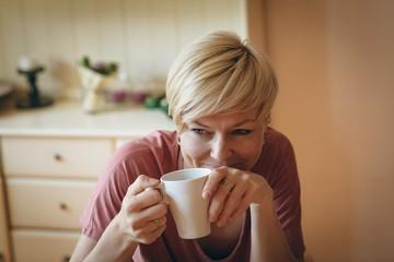 Smiling woman having coffee