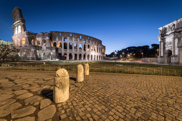 Colosseum at twilight, Rome, Italy, Europe. Ancient arena of gladiator fights. Colosseum is the most important landmark of Rome and Italy.