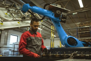 Male worker checking a machine part