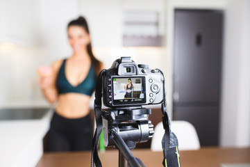 Young female vlogger recording content for her video blog. Fitness and healthy lifestyle concept.