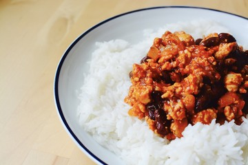 Mexican Chilli con carne served with fluffy rice - filter applied