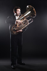 Photo sur Aluminium Musique Tuba player brass instrument. Classical musician man horn player
