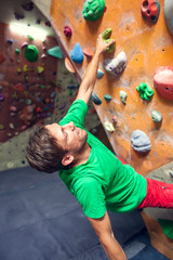 Rock climbing in the gym.
