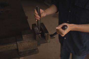 Female worker working in the workshop