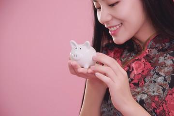 Little Piggy bank in hand.