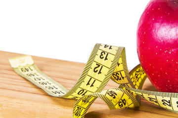 Diet and slimming concept. apple and tape measure