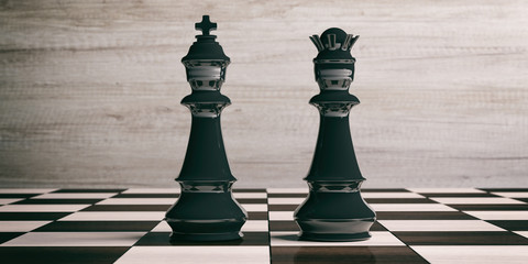 Black chess king and queen on a chessboard. 3d illustration