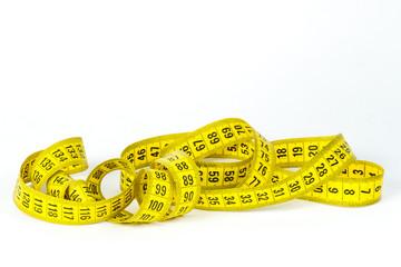 Entangled measuring tape on white background