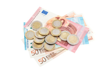 Euro coins with euro bills on white background. Business concept.