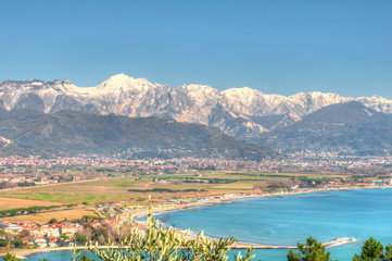 Snowy Apuan Alps and the Ligurian Riviera