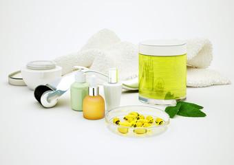 Serum, retinol, moisturizer, glass vial and derma roller for skincare rejuvenating treatment concept.