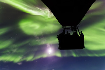 Hot air balloon on a background of the Northern Lights