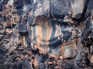 gloomy rocks on the coast of the island, North Seymour, Galapagos, Ecuador