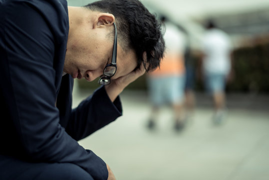 businessman stressed from work. anxiety in adult cause to depression and a problem in living that drag you down to feeling sadness,lonely and worried.