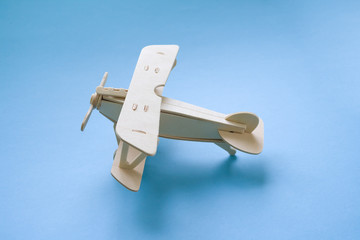 wooden children's plane on a blue background