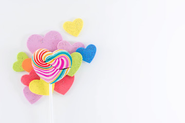 Love and Valentines Day Concept. Heart Sweet Lollipop  Candy Lay on White background with many Colorful heart shape, Varieties of Gender