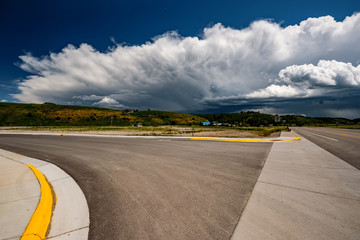 Empty open highway and stormy clouds in Wyoming