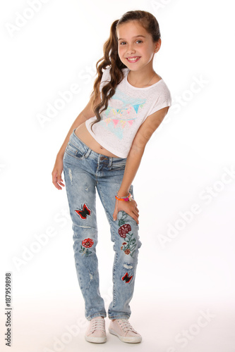 Pretty Beautiful Happy Brunette Young Teen Girl In Blue Jeans And A Bare Belly The