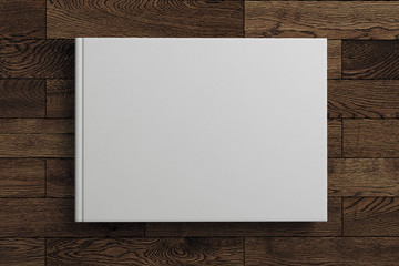 Blank white book on wooden background
