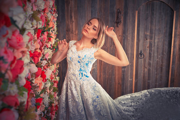 Woman with fantasy fancy dress posing in a dreamy place