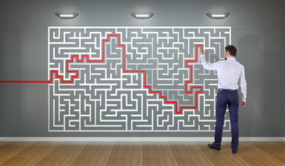 Businessman searching maze solution on a wall 3D rendering