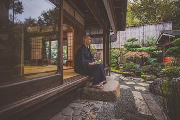 Japanese man meditating in his garden