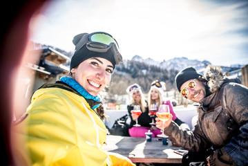 Group of friends having fun in a ski resort