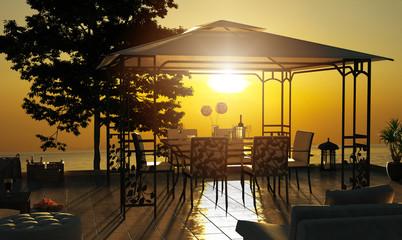 Sonnenterrasse bei Sonnenuntergang mit Pavillon und Meer im Hintergrund Wall mural