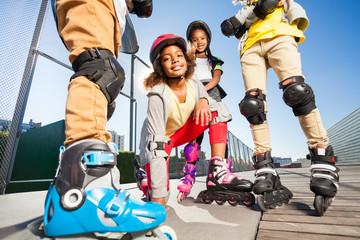 African girl on roller skates outdoors at stadium