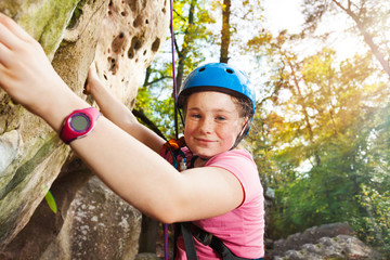 Teenage climber training on a very difficult route