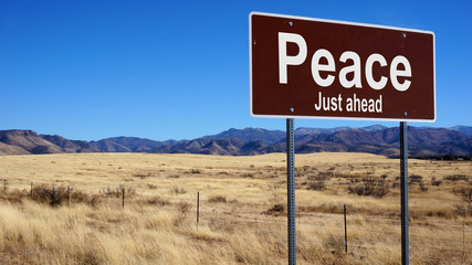 Peace brown road sign